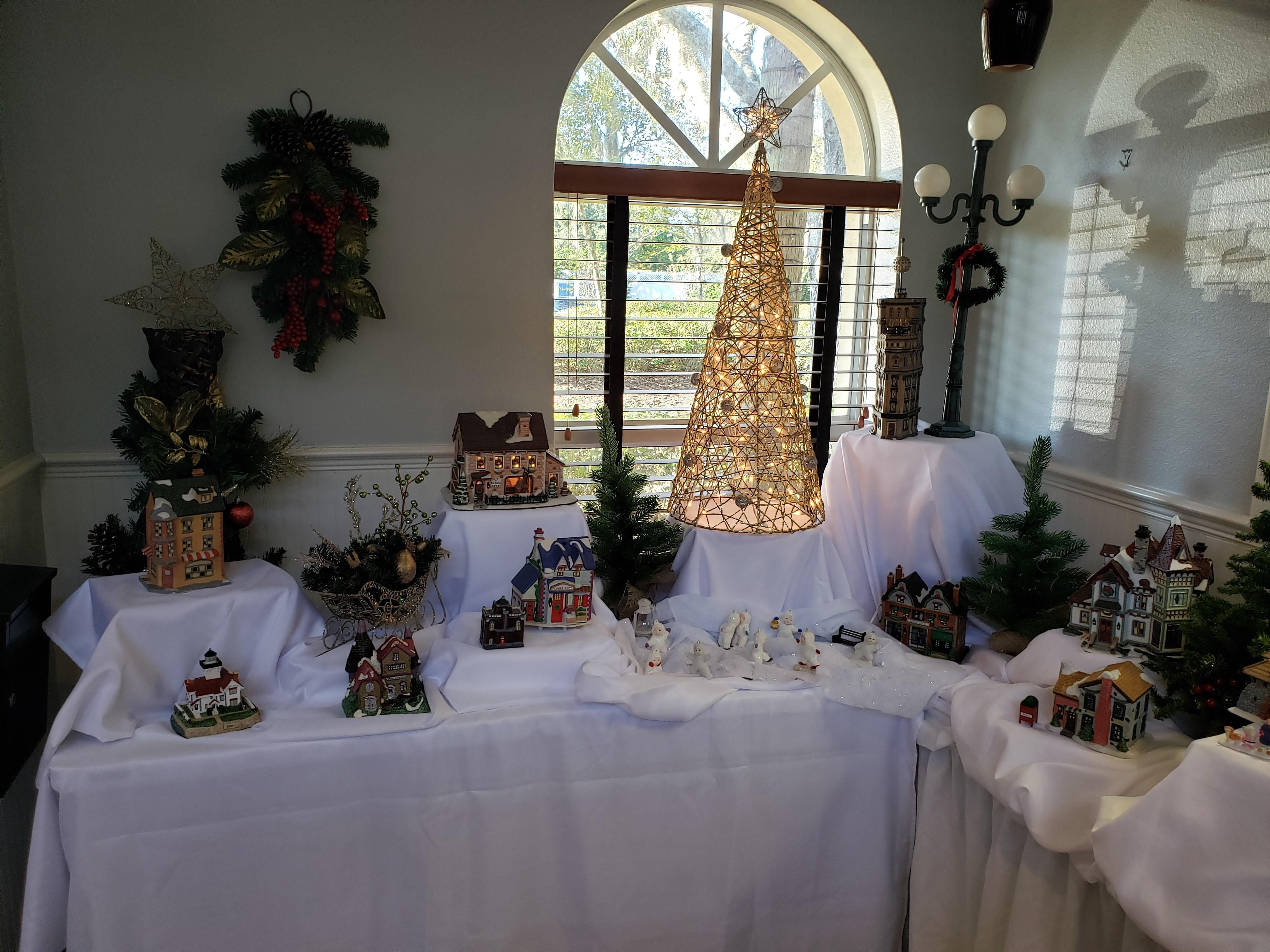 Inside Clubhouse with little decorated Christmas houses